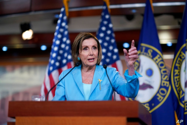 Speaker of the House Nancy Pelosi, D-Calif., talks to reporters just after the Supreme Court dismissed a challenge to the Obama…