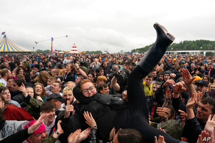 A festivalgoer crowd surfs on the first day of Download Festival at Donington Park at Castle Donington, England, Friday June 18...