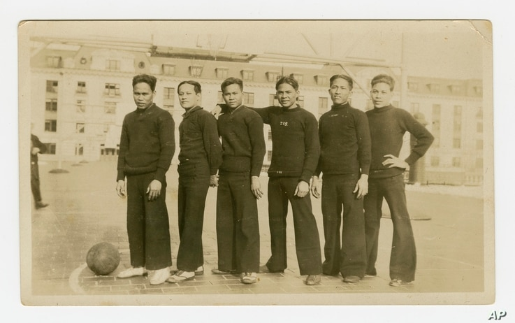 In this 1926 photo provided by the Rita M. Cacas Filipino American Community Archives, University of Maryland, are Filipino sailors in athletic uniforms at US Naval Academy in Annapolis, Maryland.