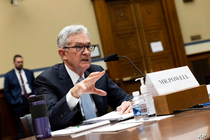 Federal Reserve Board chairman Jerome Powell testifies on Capitol Hill.