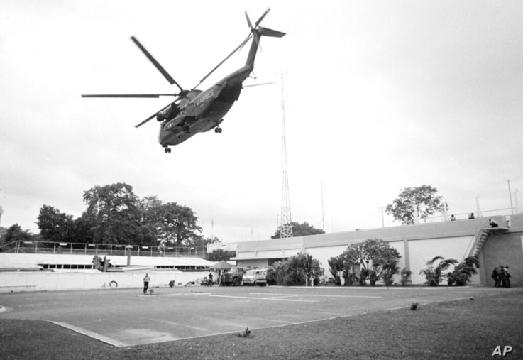 FILE - In this April 29, 1975, file photo the helicopter zone at the U.S. Embassy in Saigon, Vietnam, showing last minute...