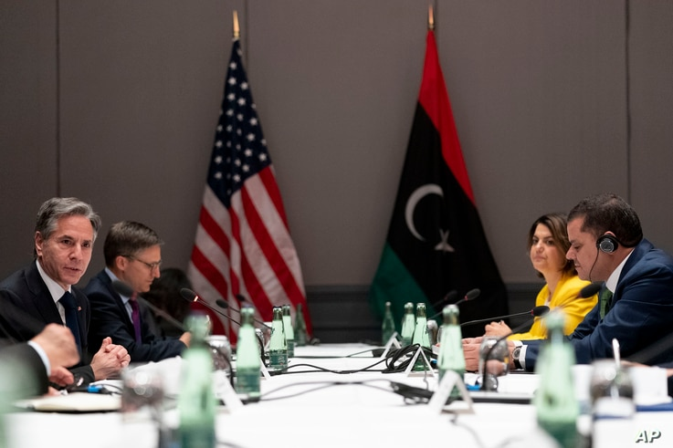 U.S. Secretary of State Antony Blinken, left, speaks as he meets with Libyan Prime Minister Abdulhamid Dbeibeh, right