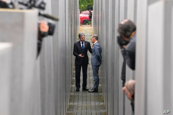 Media cover US Secretary of State Antony Blinken, left, and German Foreign Minister Heiko Maas as they talk together inside the...