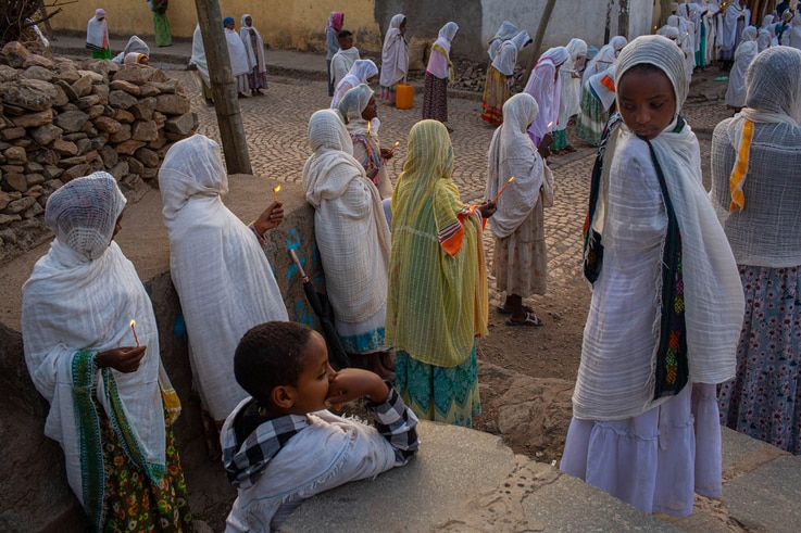 Worshippers gather outside a church complex in Axum, the holiest city for Orthodox Ethiopians, June 11, 2021. (Yan Boechat/VOA)