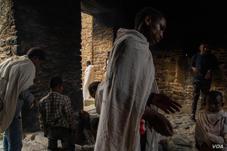 At the oldest church in Axum, Ethiopians collect ashes from a pit fire that is believed to be blessed, in Axum, Ethiopia, June 11, 2021. (Yan Boechat/VOA)