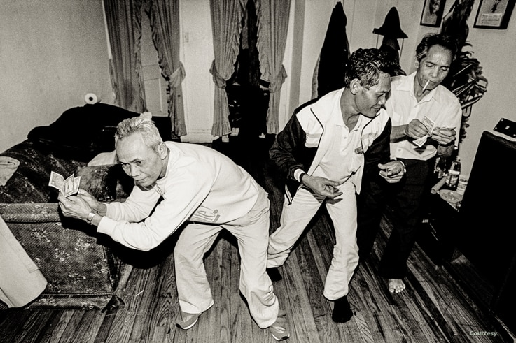 Elderly Cambodian men are dancing at an apartment building in Uptown, Chicago. (Photo: Stuart Isett)