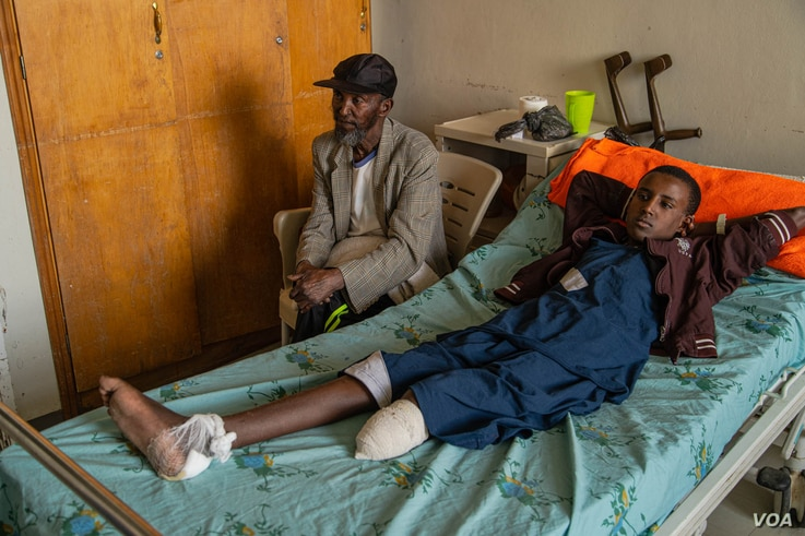 Michaele Kahsay, 16, who was injured by artillery fire and lost the lower part of his left leg, is pictured in Mekelle, Ethiopia, June 4, 2021. His brother was also injured and he did not survive. (Yan Boechat/VOA)