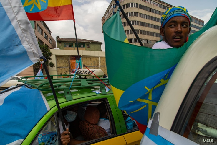 A supporter of one of the opposition parties takes part in a rally on the last day of the campaign for upcoming national elections in Addis Ababa, Ethiopia, June 16, 2021. (VOA/Yan Boechat)