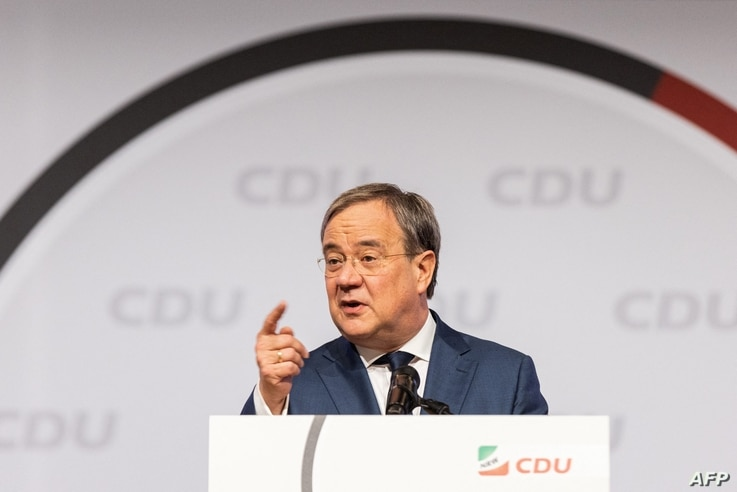 FILE - North Rhine-Westphalia's State Premier Armin Laschet, a candidate for chancellor of the conservative Christian Democratic Union (CDU) party, speaks at the regional CDU assembly in Duesseldorf, Germany, June 5, 2021.