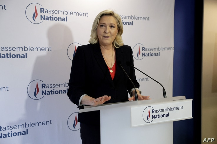 French far-right Rassemblement National (RN) party's leader Marine Le Pen speaks to the press at the party's headquarters after the first results in the second round of French regional elections, in Nanterre, June 27, 2021.