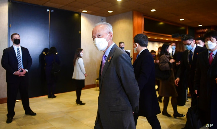 China's Ambassador to the U.S. Cui Tiankai walks past the closed-door morning session of US-China talks in Anchorage, Alaska on…