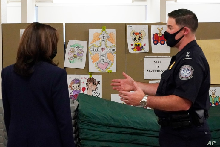 Vice President Kamala Harris looks at pictures drawn by children as she visits the Paso del Norte (PDN) Port of Entry.