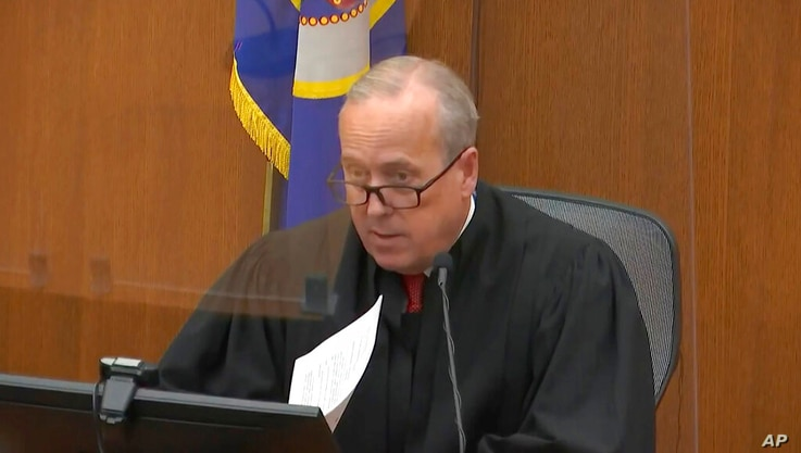 In this image taken from the video, Hennepin County Judge Peter Carhill presides over a former Minneapolis police decision ...
