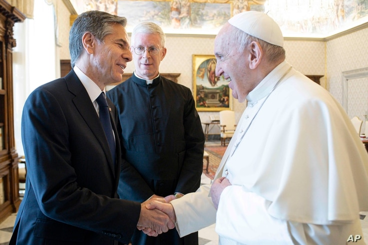 Pope Francis shakes hands with Secretary of State Antony Blinken, as they meet at the Vatican, June 28, 2021.