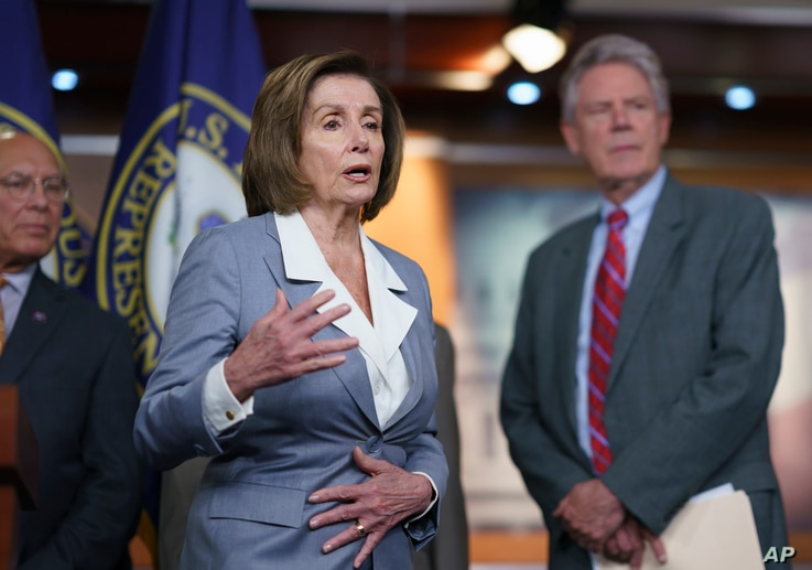 Speaker of the House Nancy Pelosi, D-Calif., responds to a question about her creation of a select committee to investigate the...