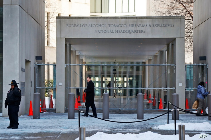 In this Thursday, Jan. 23, 2014 photo, a security official walks in front of the entrance to the national headquarters of the…