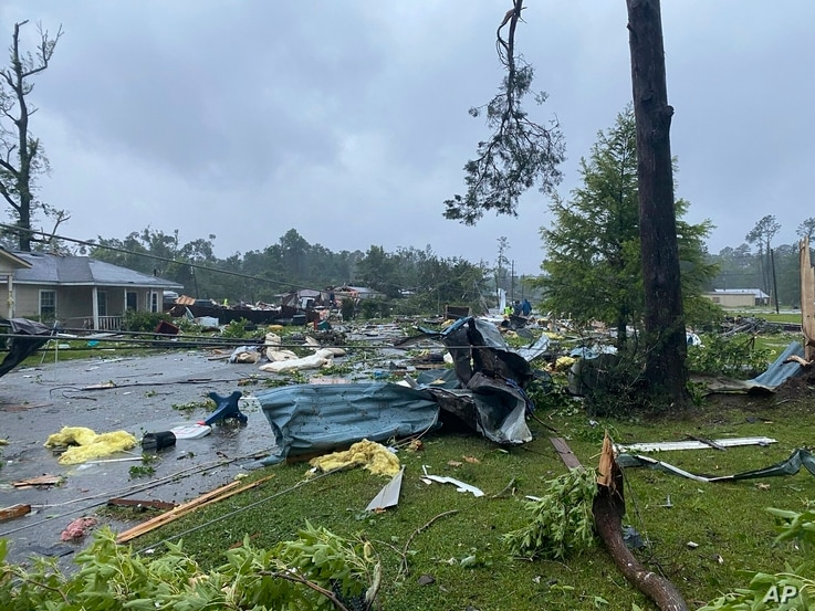 This photo provided by Alicia Jossey shows debris covering the street in East Brewton, Alabama, June 19, 2021.