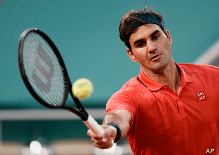 Switzerland's Roger Federer returns a shot to Germany's Dominik Koepfer during their  match on day seven of the French Open tennis tournament at Roland Garros in Paris, France, June 5, 2021.