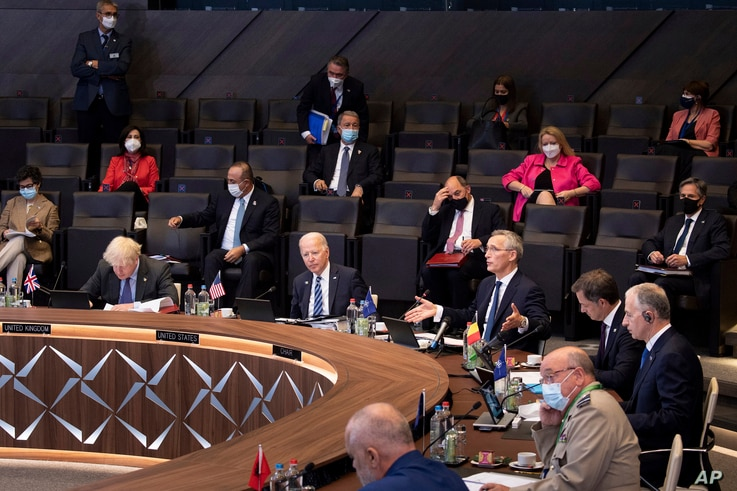 NATO Secretary General Jens Stoltenberg, center-right, opens a plenary session during a NATO summit at the alliance's headquarters in Brussels June 14, 2021.