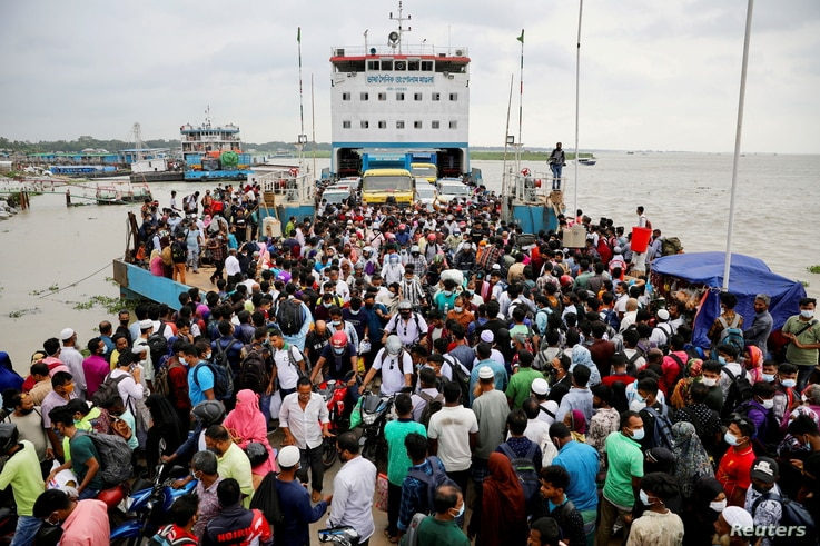 People board an overcrowded ferry as they return home a day before a countrywide lockdown is imposed in Munshiganj, outskirts of Dhaka, Bangladesh, June 30, 2021.