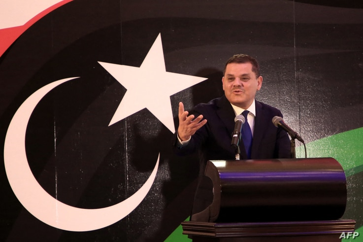 Libya's prime minister-designate Abdul Hamid Dheibah speaks during a press conference in the capital Tripoli, on February 25,…