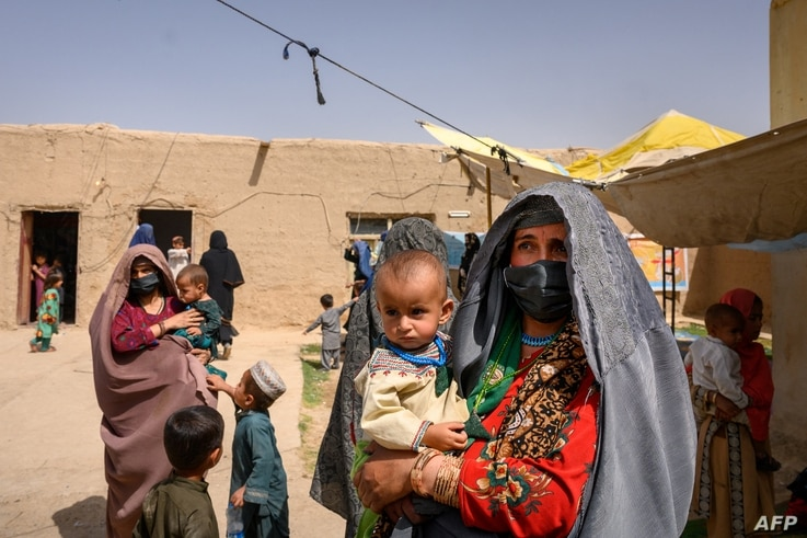 In this picture taken on March 28, 2021, Farzana, who fled her village in Helmand province when it was taken over by the...