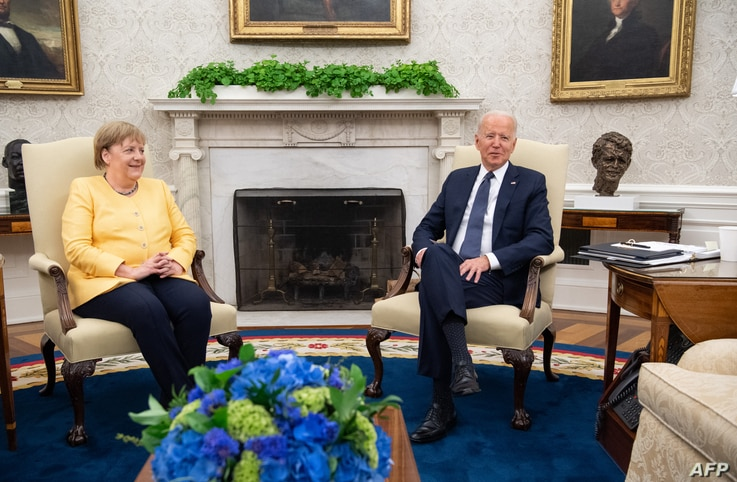 US President Joe Biden and German Chancellor Angela Merkel hold a meeting in the Oval Office of the White House in Washington,...