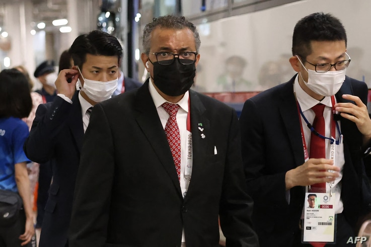 World Health Organization (WHO) Director-General Tedros Adhanom (C) arrives for the opening ceremony of the Tokyo 2020 Olympic...