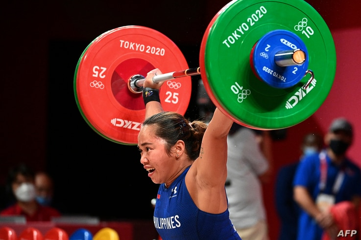 Philippines' Hidilyn Diaz competes in the women's 55kg weightlifting competition during the Tokyo 2020 Olympic Games at the...