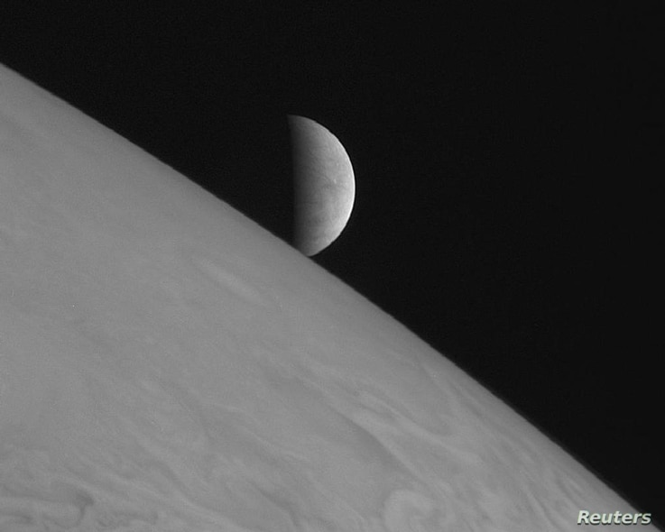 New Horizons took this image of the icy moon Europa rising above Jupiter's cloud tops after the spacecraft's closest approach…
