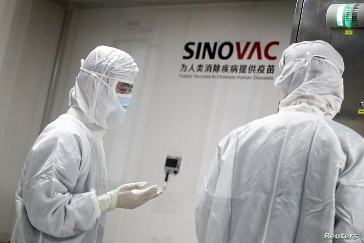 People work in a laboratory at Chinese vaccine maker Sinovac Biotech, which is developing an experimental coronavirus disease (COVID-19)...