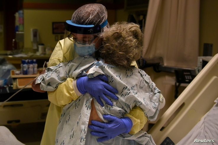 FILE PHOTO: Healthcare personnel prepare to discharge a patient who had been quarantining after a possible exposure to the...