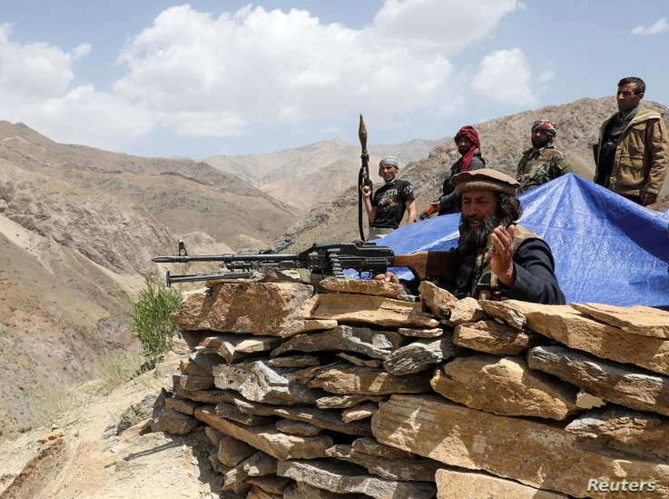 Armed men who are against Taliban uprising stand at their check post, at the Ghorband District, Parwan Province, Afghanistan…