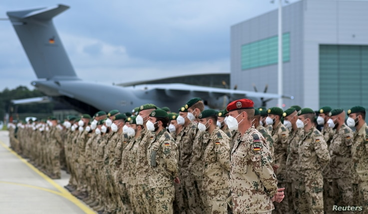 German soldiers line up for the final roll call in front of an German armed forces Bundeswehr Airbus A400M cargo plane after…