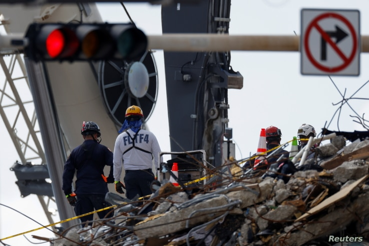 Rescue personnel continue the search and rescue operation for survivors at the site of a partially collapsed residential…