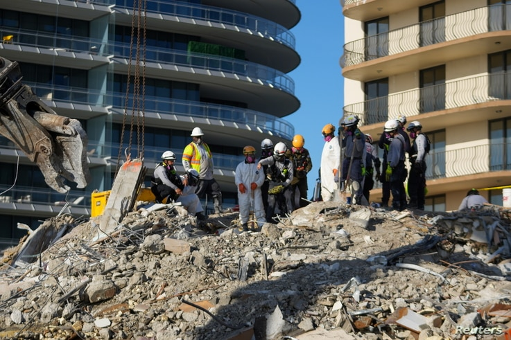Search and rescue personnel work at the site of a collapsed Florida condominium complex in Surfside, Miami, U.S., in this…