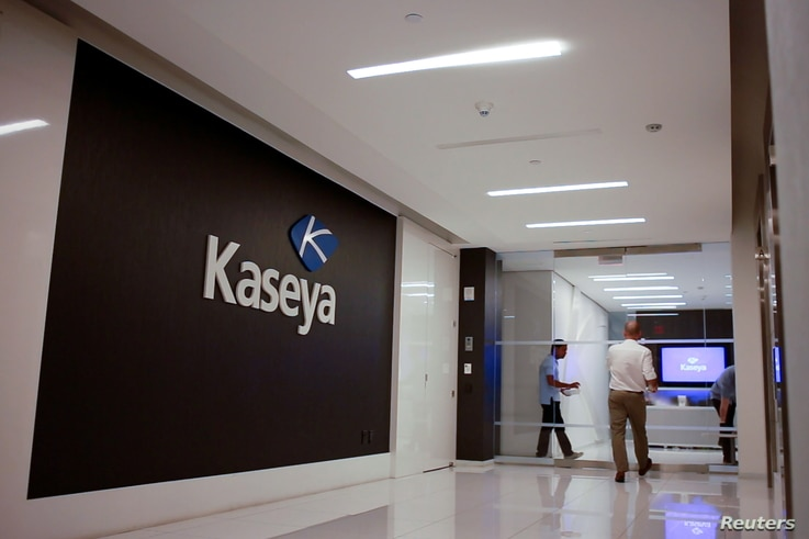 Staff enter the headquarters of information technology firm Kaseya in Miami, Florida, U.S., in an undated still image from…