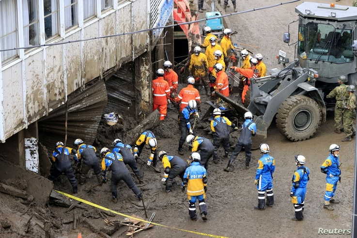 Rescuers conduct rescue and search operation at a mudslide site caused by heavy rain at Izusan district in Atami, west of Tokyo…