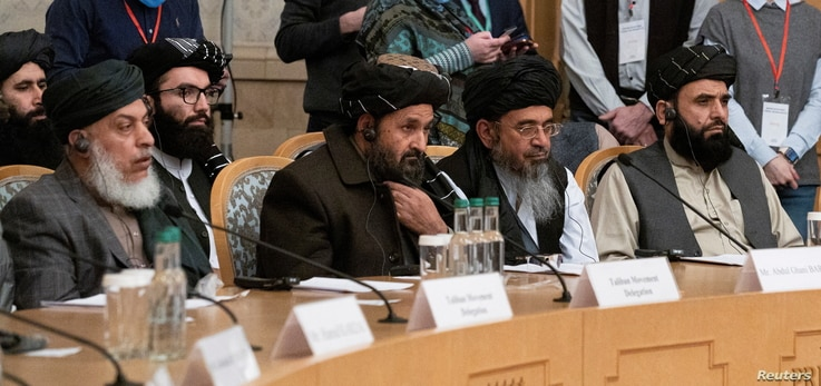 FILE PHOTO: Mullah Abdul Ghani Baradar, the Taliban's deputy leader and negotiator, and other delegation members attend the…