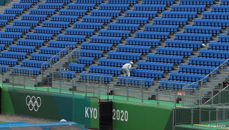 A worker inspects seats at Tokyo2020 Olympic BMX Track in preparation for the Tokyo 2020 Olympic Games in Tokyo, Japan June 30,…