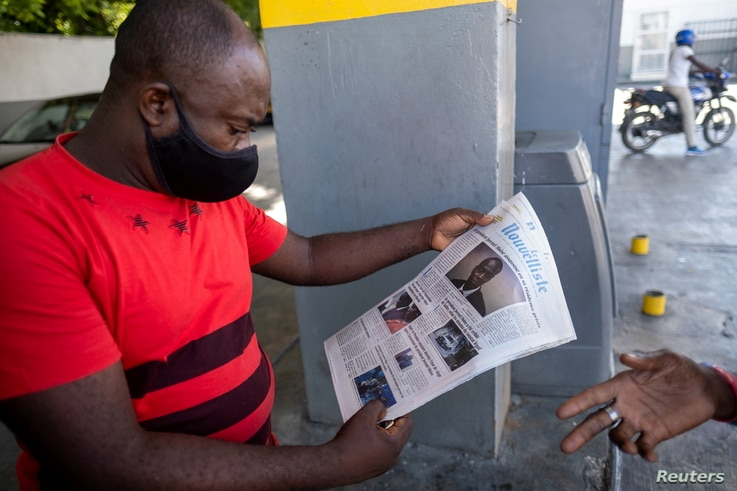 A man reads the front page of a local newspaper with the news of the assassination of President Jovenel Moise, in Port-au…