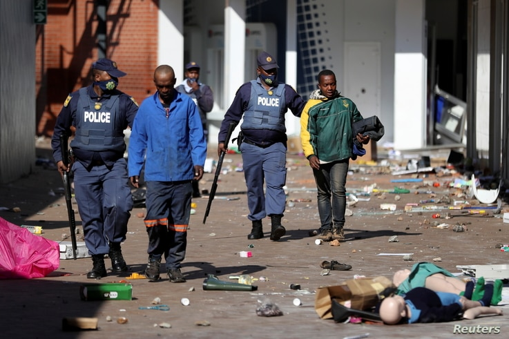 Police officers detain demonstrators during protests following the imprisonment of former South Africa President Jacob Zuma, in…