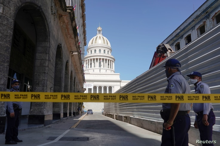 A police line is seen blocking a road leading to the National Capitol Building, in Havana, Cuba, July 12, 2021. REUTERS…