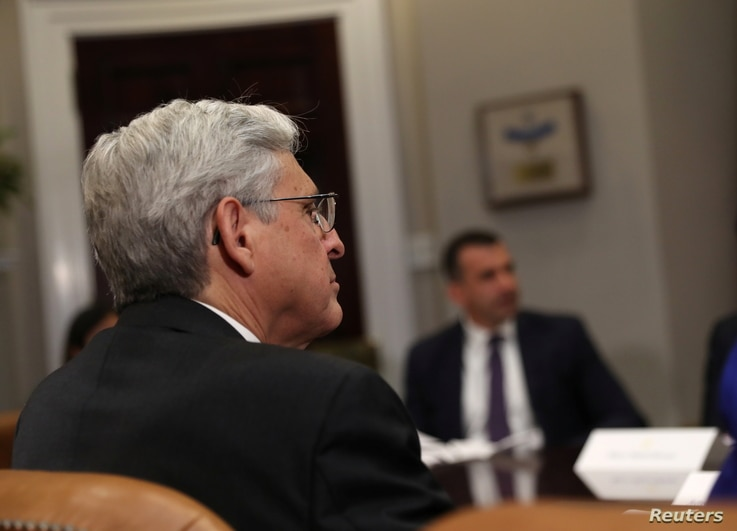 U.S. Attorney General Merrick Garland takes part in a meeting with President Joe Biden, law enforcement officials, and…