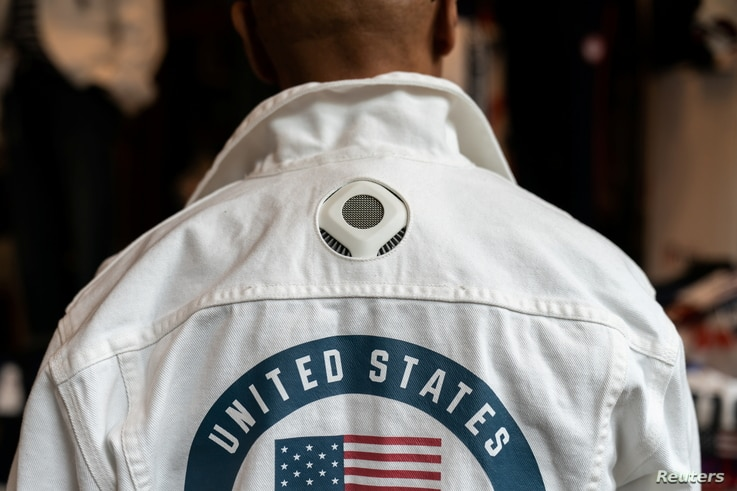 A former flag bearer and 6-time Olympian Peter Westbrook presents the official Opening Ceremony uniforms of the United States…