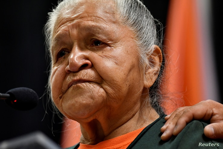 Residential school survivor Evelyn Camille speaks at a presentation of the findings on 215 unmarked graves discovered at...