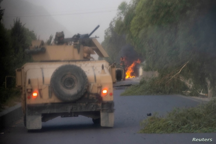 FILE PHOTO: Humvees that belong to Afghan Special Forces are seen destroyed during heavy clashes with Taliban during the rescue...