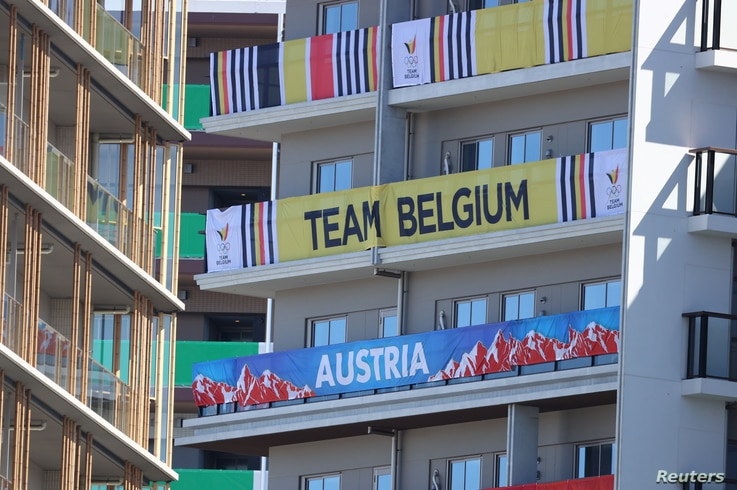 Tokyo 2020 Olympics Preview - Tokyo, Japan - July 18, 2021 Signs from the Belgium and Austria Olympic teams hang on the...