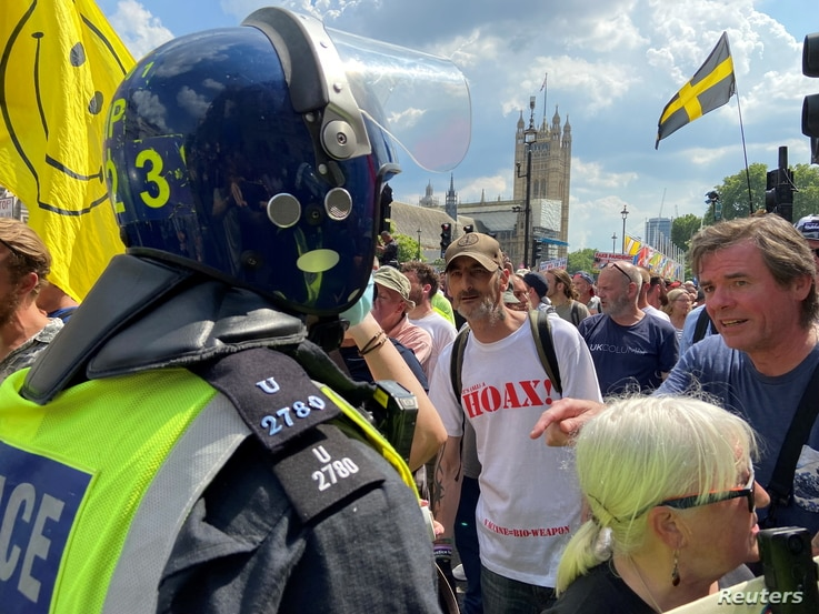 Protesters take part in an anti-lockdown demonstration in London's Parliament Square amid coronavirus disease (COVID-19)…