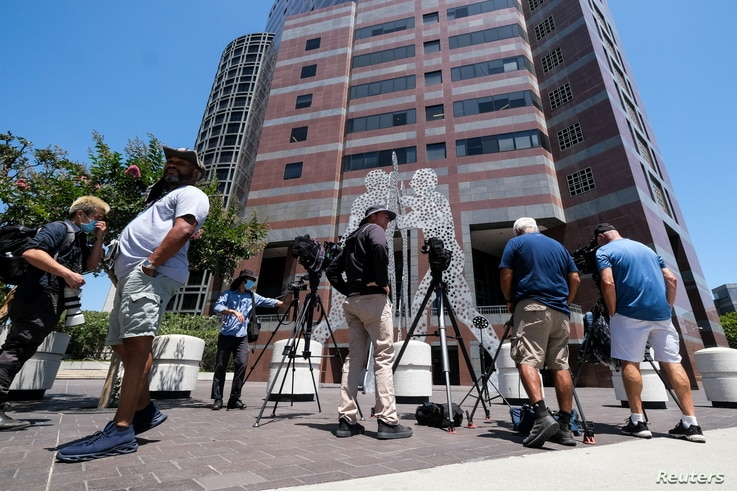 Members of the media wait outside federal court building after Thomas Barrack, a billionaire friend of Donald Trump who chaired…